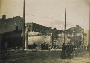 Policeman and woman in front of ruins on Bank Street, Waterbury