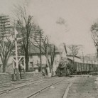 The N.Y. N.H. & H. Railroad pulling into a Willimantic station