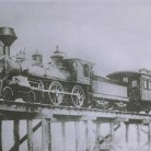 "Locomotive number 9 ""the Simsbury"" going over a trestle bridge, 1878"