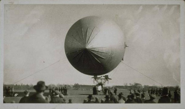 United States Army dirigible with crowd of onlookers