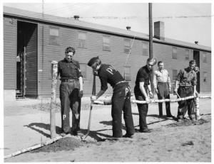 German POWs repairing fence, Bradley Field