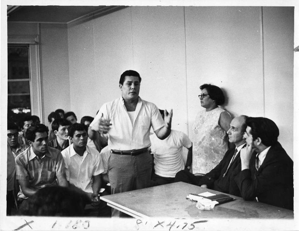 Maria Sánchez (leaning against the wall) in a meeting with city officials, Hartford, 1969
