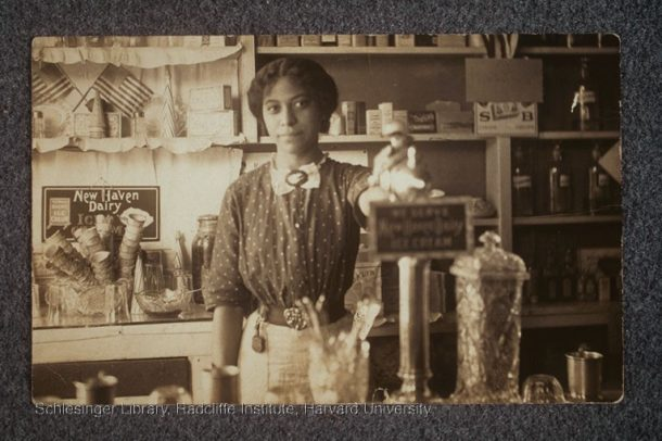 Anna Louise James behind the soda fountain in the James' pharmacy