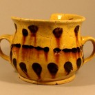 "An English yellow slipware ""posset pot"" found on the cellar floor of the Goodsell house in North Branford. By the time Lydia Goodsell died in about 1797, this post-medieval-style earthenware cup would have been very outdated, but it was still considered serviceable - AHS, Inc., Storrs"