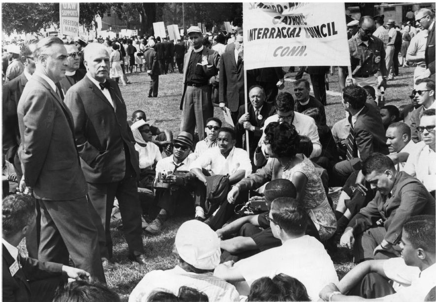 US Senator Abraham A. Ribicoff, far left, and US Senator Thomas J. Dodd, second from left, met with Connecticut men and women attending the March on Washington for Freedom and Jobs on August 29, 1963. An estimated 3,000 people from Connecticut were at the march. Photographer Unknown - Hartford Times Collection, Hartford History Center, Hartford Public Library