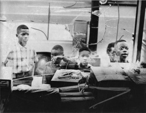 During July 1967, several Hartford children look into a broken storefront window. Many businesses in North Hartford were attacked during the riots, and Hartford, along with Newark, New Jersey, became a national symbol of racial unrest. Photographer Unknown - The Hartford Times Collection, Hartford History Center, Hartford Public Library