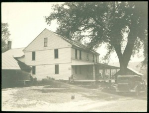 A two-story frame house in the Hartland Hollow area which was flooded when the Barkhamsted Reservoir was completed - Connecticut Historical Society and Connecticut History Online