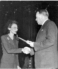 Governor Baldwin awards Mrs. Alexander a certificate and Distinguished Service Medal