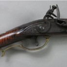 The lock and trigger assembly on the Deming rifle neatly combine function and aesthetics