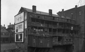 Detail from a glass plate negative showing the rear of one of the tenements that lined the Park River