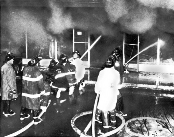 Firemen work to douse the last flames of a fire that swept through Gulliver's Restaurant