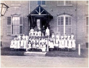 Matron, staff, and children at the Rogers House