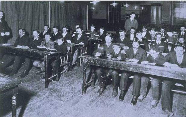 A group of Italian immigrants attending a class in English language