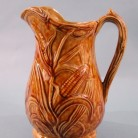 Mold-formed stoneware pitcher. Made by Sidney Risley, 1850-1875