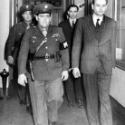 Uniformed military police escort Erich Gimpel, right foreground, and William C. Colepaugh, background, into court at Governors Island, NY March 3,1945, for another trial session. Both were subsequently convicted as Nazi spies and sentenced to die by hanging - © The Associated Press/U.S. Army