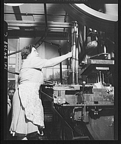 Woman working in the Stanley plant operating a machine which cuts out material for steel bullet jackets, New Britain, ca. 1943 - Library of Congress, Prints and Photographs Division, Office of War Information