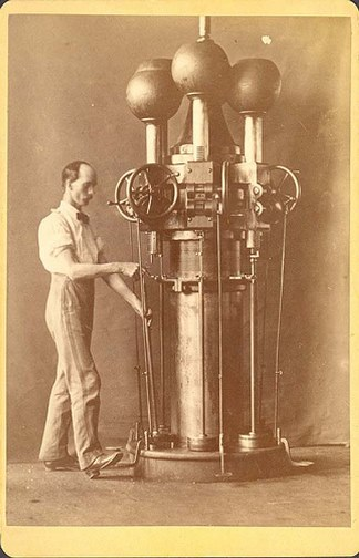 Colt machinist with a barrel-rifling machine, a specialized machine tool invented by superintendent Elisha Root, 1860s - Connecticut State Library, Colt's Patent Fire Arms Manufacturing Company