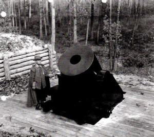 "Former Confederate Captain Carter Bishop stands by the concrete replica of the famed mortar at Petersburg, Virginia, in 1935. Photograph from ""Construction of Replica Petersburg Express"" by Manning C. Voorhis - National Park Service"