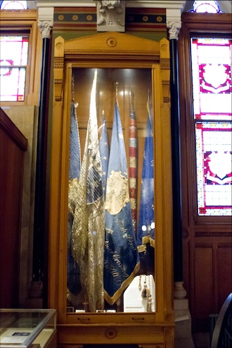The flags of the 11th, 14th, and 16th Regiments are located in this glass cabinet in the Hall of Flags at the Connecticut State Capitol building - Courtesy of Stacey Renee