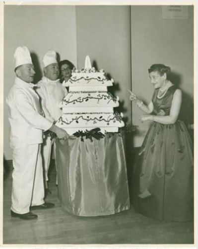 Beatrice Fox Auerbach with Moses Fox Club cake and chefs, 1958 - Connecticut Historical Society and Connecticut History Online