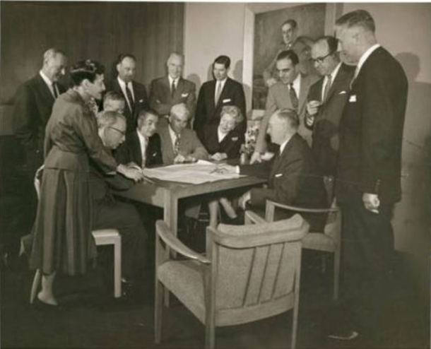 Beatrice Fox Auerbach meets with the department heads of her store, G. Fox & Company