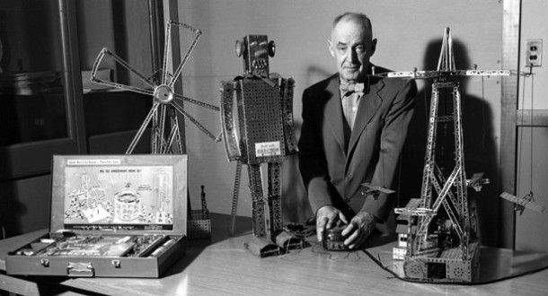A. C. Gilbert posing with various Erector Set models - Gilbert Family Collection