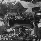 "The Belgium booth at ""The Allied Market,"" The Sister Susie Society's first World War I fundraiser fair, held on the Washington Green on August 5, 1916 - Gunn Memorial Museum"