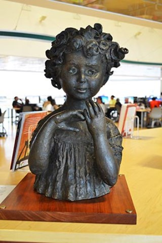 Julia, bronze statue by Elbert Weinberg, on view in the lobby of the Hartford Public Library - Photograph by Pramod Pradhan, Hartford History Center, Hartford Public Library
