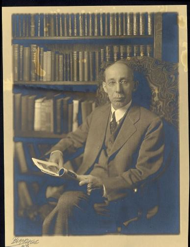 Inventor Curtis H. Veeder in the library of his home at One Elizabeth Street, Hartford. The building now houses The Connecticut Historical Society, ca. 1930 - Connecticut Historical Society
