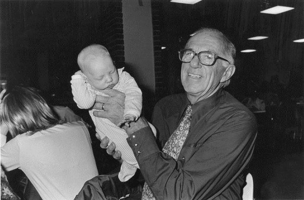 Dr. Spock holding baby, April 19, 1977. © John Gillooly - Suffolk University, Moakley Archive & Institute