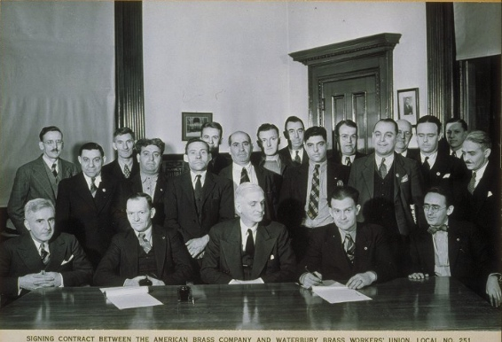 Signing Contract Between The American Brass Company And Waterbury Brass Workers Union, Local No. 251, 1938 - Archives & Special Collections at the Thomas J. Dodd Research Center, University of Connecticut Libraries