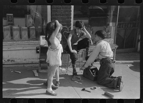 Children shining shoes on street corner, Hartford, Connecticut, 1941. Photograph by Marion Post Wolcott - Library of Congress, Prints and Photographs Division, Office of War Information Photograph Collection
