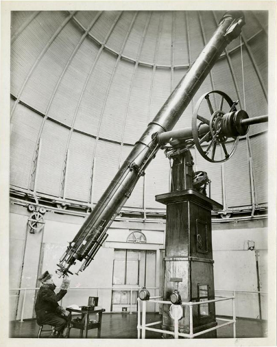 Frederick Slocum sits at the 20-inch refracting telescope.