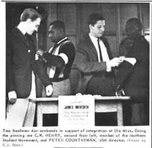 Two freshman don armbands in support of integration at Ole Miss. Doing the pinning are C. W. Henry, second from left, member of the Northern Student Movement, and Peter Countryman, NSM director. (Photo by E. J. Shaw) - Yale Daily News, no. 13, October 3, 1962