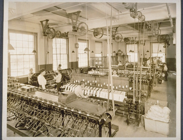 Mill interior, Cheney Brothers Silk Manufacturing Company, 1918. Woman supervising boys at work, apparently winding silk thread - Connecticut Historical Society