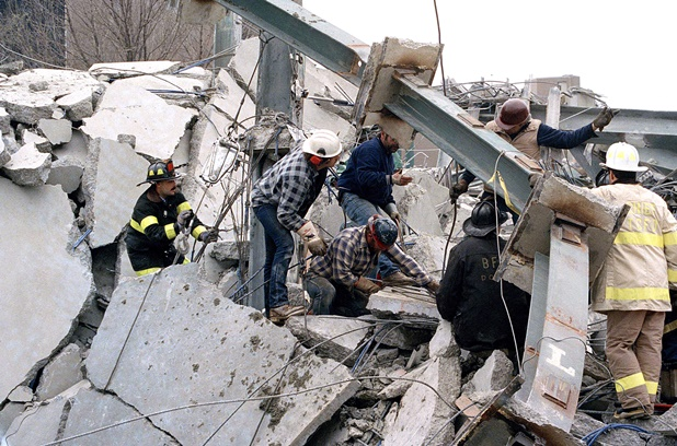 Rescuers dig through the rubble of an apartment building that collapsed in Bridgeport, Connecticut, Thursday, April 23, 1987 while under construction. One person was killed and an undetermined number of workers were injured or trapped in the rubble of the collapse - © Associated Press photo