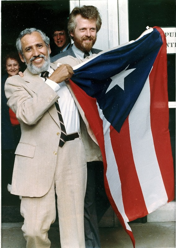Filiberto Ojeda Rios displays a Puerto Rican flag as he left U.S. District Court in Hartford