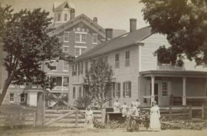 Shaker women and buildings, Enfield, 1890s