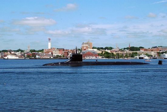 USS Seawolf sails past downtown New London