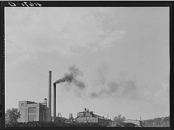 The Naugatuck Chemical Company with piles of old rubber tires