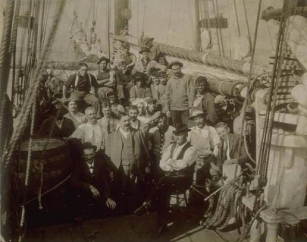 Captain James W. Buddington and crew on whaling schooner