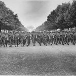 American troops of the 28th Infantry Division march down the Champs-Élysées