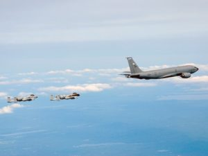Two A-10 Thunderbolt IIs from the Connecticut Air National Guard's 103rd Fighter Wing fly in formation behind a KC-135