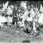 School children placing flowers on the graves of World War I servicemen